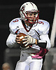 Clarke quarterback No. 9 Corey Rosenbloom looks for an open receiver during a Nassau County varsity football Conference IV semifinal against Seaford at Hofstra University on Thursday, Nov. 12, 2015. <br /> <br /> James Escher