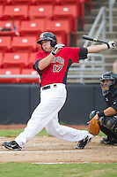 Zach Zaneski #17 of the Hickory Crawdads follows through on his swing against the Kannapolis Intimidators at  L.P. Frans Stadium August 1, 2010, in Hickory, North Carolina.  Photo by Brian Westerholt / Four Seam Images