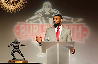 NWA Media/DAVID GOTTSCHALK - 12/8/14 - Justin Hardy of East Carolina University accepts the 2014 Burlsworth Trophy Monday December 8, 2014 at the a ceremony presented by the Springdale Rotary Club at the Springdale Convention Center. The other finalist for the aware were Ben Beckwith, from Mississippi State University, and Mark Weisman,  from the University of Iowa. Additional photographs available at:  nwaonline.com/photos