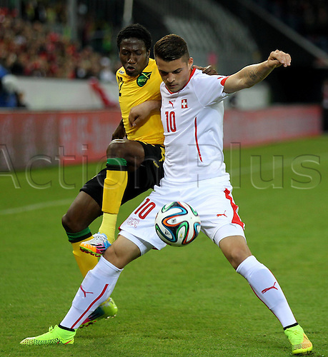 30.05.2014. Lucerne, Switzerland. International football friendly. Switzerland versus Jamaica.  Demar Philips (JAM) tackles  Grabit Xhaka (SUI)