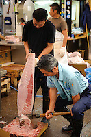 Workers in the market, Tsukiji fish market, Tokyo, Japan, October 23 2009.