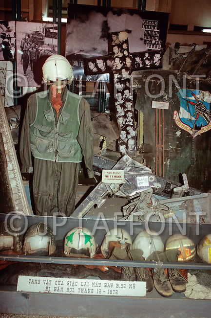 Hanoi, February 1988. The War Museum in Hanoi. Pilot's helmets, the victorious Russian T54 tanks, the debris of B52 aircraft, various US weapons and amunition are exhibited.