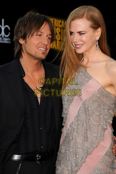 KEITH URBAN & NICOLE KIDMAN.The 2009 American Music Awards held at The Nokia Theatre L.A. Live in Los Angeles, California, USA. .November 22nd, 2009.AMA AMA's half length pink grey gray lace dress black suit jacket married husband wife  one shoulder .CAP/ADM/BP.©Byron Purvis/AdMedia/Capital Pictures.