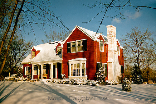 Traditional clapboard house on snowy day in Midwest USA, Missouri