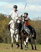 Patrick O'Reilly of Virginia takes control of the ball from Jessie Reed of Doylestown, Pa. during a polocrosse match held at the Bucks County Horse Park in Revere, Pa., on Sunday October 23, 2005. (JANE THERESE/Special to The Morning Call).