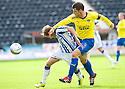 KILMARNOCK'S JAMES DAYTON IS CAUGHT BY THE ARM OF PARS AUSTIN MCCANN