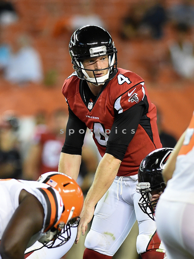 CLEVELAND, OH - AUGUST 18, 2016: Quarterback Matt SImms #4 of the Atlanta Falcons takes the snap from under center in the fourth quarter of a preseason game on August 18, 2016 against the Cleveland Browns at FirstEnergy Stadium in Cleveland, Ohio. Atlanta won 24-13. (Photo by: 2016 Nick Cammett/Diamond Images) *** Local Caption *** Matt Simms