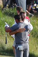 Brooks Koepka (USA) is congratulated by Dustin Johnson (USA) on the 18th green after winning the 118th U.S. Open Championship at Shinnecock Hills Golf Club in Southampton, NY, USA. 17th June 2018.<br /> Picture: Golffile | Brian Spurlock<br /> <br /> <br /> All photo usage must carry mandatory copyright credit (&copy; Golffile | Brian Spurlock)