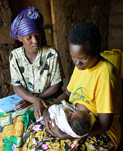 Community Health Worker Marie Chantal monitors a mom nursing her three-week old newborn in Batamuliza Hururiro village, near Rukumo Health Center, Rwanda