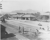 Brick railroad depot build in 1910.  Section gang working near depot.<br /> D&amp;RG  Canon City, CO  Taken by Beam, George L. - ca 1910