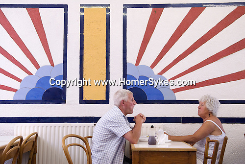 "An English ""sunrise"" motif in a cafe  Southend on Sea, Essex. England. 2006. Baileys Fish and Chip shop."