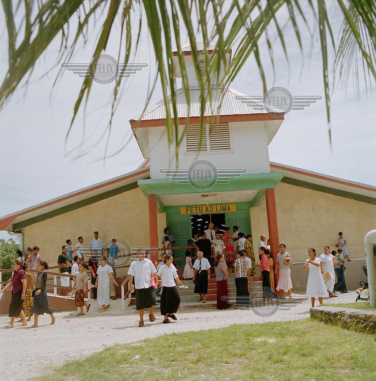 The congregation disperse outside the Ekalesia Kelisiano Tuvalu, the Christian Church of Tuvalu, after a Sunday service...