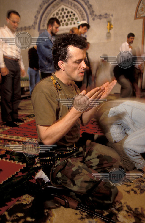 Muslim soldier at prayer..Around 250,000 people died in the civil war between Bosnian Muslims, Croats and Serbs in the years 1992-1995, part of the break-up of the former Yugoslavia.