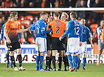 Dundee United v St Johnstone...12.03.14    SPFL<br /> Ref Crawford Allan separates David Wotherspoon and Sean Dillon<br /> Picture by Graeme Hart.<br /> Copyright Perthshire Picture Agency<br /> Tel: 01738 623350  Mobile: 07990 594431