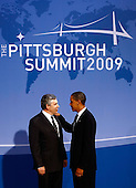 Pittsburgh, PA - September 24, 2009 -- United States President Barack Obama (R) greets at British Prime Minister Gordon Brown at the welcoming dinner for G-20 leaders at the Phipps Conservatory on Thursday, September 24, 2009 in Pittsburgh, Pennsylvania. Heads of state from the world's leading economic powers arrived today for the two-day G-20 summit held at the David L. Lawrence Convention Center aimed at promoting economic growth. .Credit: Win McNamee / Pool via CNP