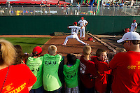 Fans watch from the edge of the bullpen as Trevor Rosenthal (44) of the Springfield Cardinals warms up during a game against the Arkansas Travelers at Hammons Field on June 13, 2012 in Springfield, Missouri. (David Welker/Four Seam Images)