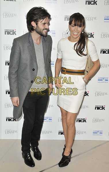 """Bobby Sabel & Tara Palmer Tomkinson.The """"A Night With Nick"""" charity event in aid of The Stroke Association, Swarovski CRYSTALLIZED, Gt. Marlborough St., London, England..December 6th, 2011.full length black jeans denim grey gray top jacket coat beard facial hair dress white profile couple tpt brown belt hand in pocket green.CAP/CAN.©Can Nguyen/Capital Pictures."""
