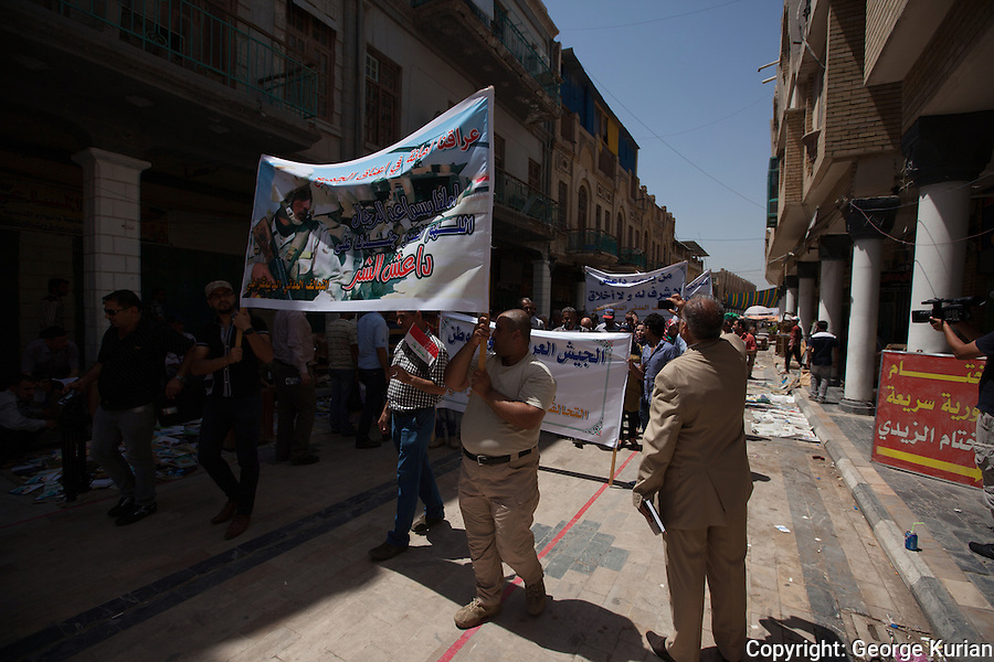 members of communist and secular groups walking in solidarity with the Iraqi army against ISIS and sectarian violence in Iraq