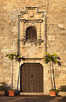 Door and window in the facade of the Museo de las Casas Reales, or Museum of the Royal Houses, in the Colonial Zone of Santo Domingo, capital of the Dominican Republic, in the Caribbean. The museum was opened in 1973 to celebrate the history and culture of the Spanish inhabitants of the colony, and is housed in a 16th century colonial palace originally serving as governor's office and Audiencia Real or Royal Court. Santo Domingo's Colonial Zone is listed as a UNESCO World Heritage Site. Picture by Manuel Cohen