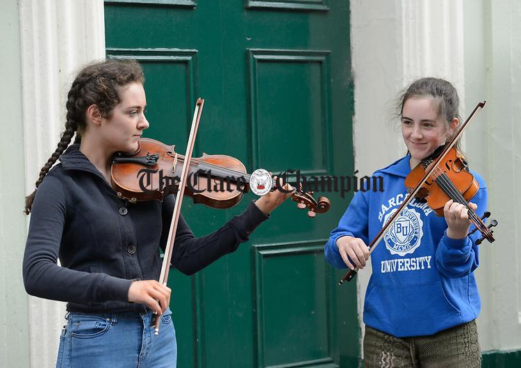 Blaithin and Grainne Behan of Roscommon busking on O Connell street during Fleadh Cheoil na hEireann in Ennis. Photograph by John Kelly.