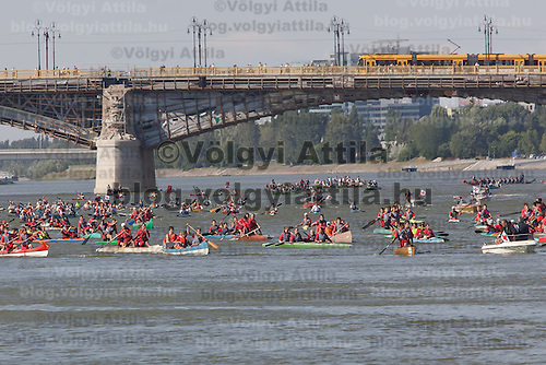 Sportsmen paddle their kayaks and canoes on river Danube in front of the Parliament as part of the Hungarian rotational EU presidency closing celebrations in Budapest, Hungary on June 25, 2011. ATTILA VOLGYI