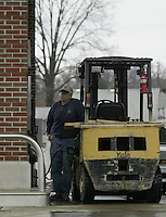 Wayne Lauvray, of Dresden, fills a fork lift at a Certified gas station Thursday, Nov. 16, 2006 in Granville, Ohio.<br />