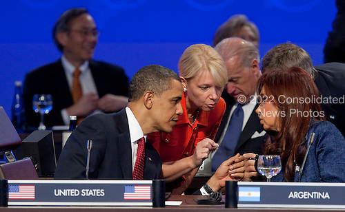 United States President Barack Obama speaks with President Cristina Fernandez de Kirchner of Argentina during the opening plenary of the Nuclear Security Summit with U.S. President Barack Obama at the Washington Convention Center in Washington, D.C., U.S., on Tuesday, April 13, 2010. Ukraine's agreement to relinquish its entire stockpile of highly enriched uranium gave Obama the first concrete result for a summit he convened on securing the world's atomic material. .Credit: Andrew Harrer / Pool via CNP