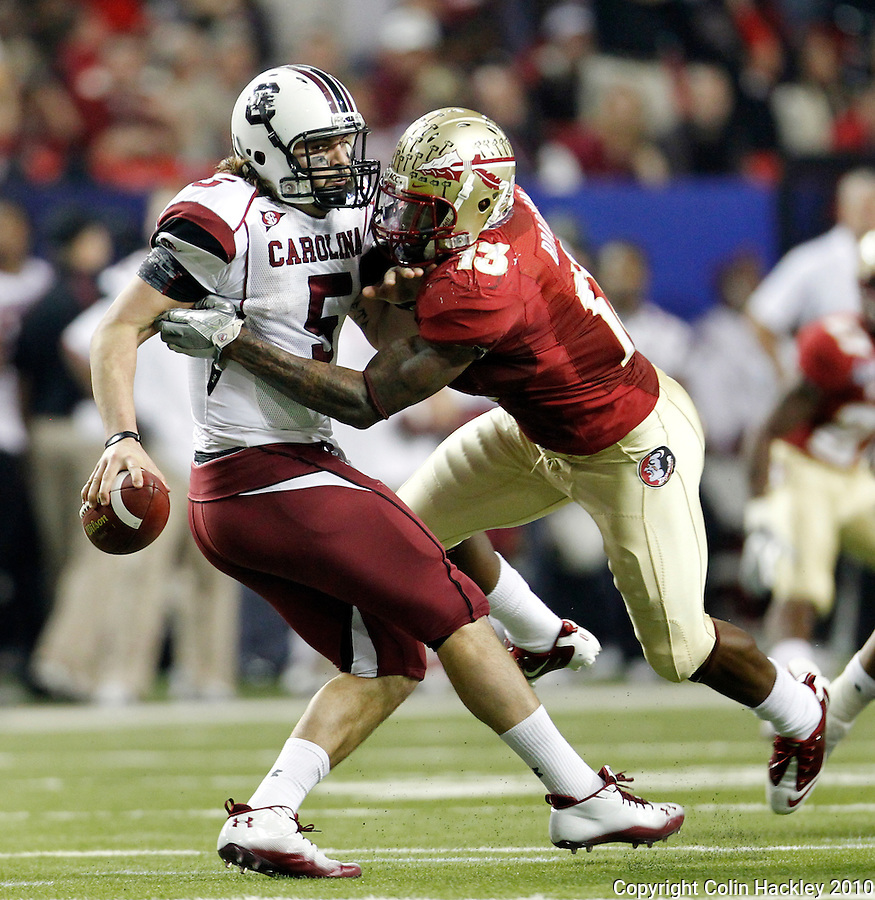 ATLANTA, AG 12/31/10-FSU-SC FB10 CH-Florida State's Nigel Bradham grabs but can not tackle South Carolina's Stephen Garcia during first half action Friday at the Chick-fil-A Bowl in Atlanta..COLIN HACKLEY PHOTO