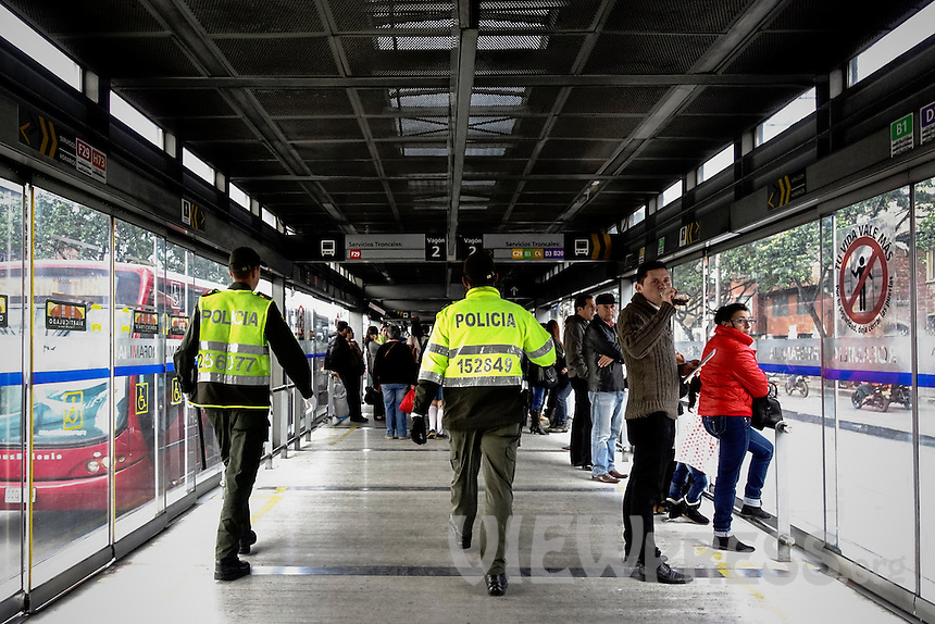 Colombian police officers patrol on station of the massive public transportation know as TRANSMILENIO in Bogota, Colombia.  05/15/2015. Eduardo MunozAlvarez/VIEWpress