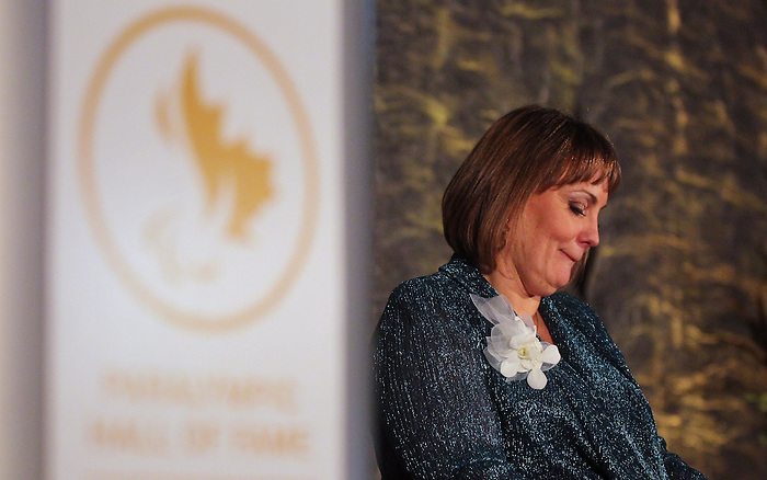 Ottawa, ON – Nov 27 2015 – Marni Abbott-Peter has a moment as she speaks at the Canadian Paralympic Hall of Fame in Ottawa, Ontario Nov 27, 2015. Abbott was inducted into the CPC Hall of Fame in the athlete category. Photo Andre Forget / Canadian Paralympic Committee