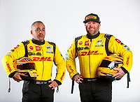 Feb 6, 2020; Pomona, CA, USA; NHRA funny car driver J.R. Todd (left) poses for a portrait with top fuel teammate Shawn Langdon during NHRA Media Day at the Pomona Fairplex. Mandatory Credit: Mark J. Rebilas-USA TODAY Sports