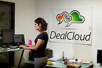 Photography of Packard Place business incubator.  Located in the heart of uptown Charlotte, NC, Packard Place is a hub for entrepreneurship and innovation, helping to grow business startups in the community. Photo shows Lucy Barber, VP of Marketing/ Member Support for Deal Cloud Nation, one of the companies located inside of Packard Place.