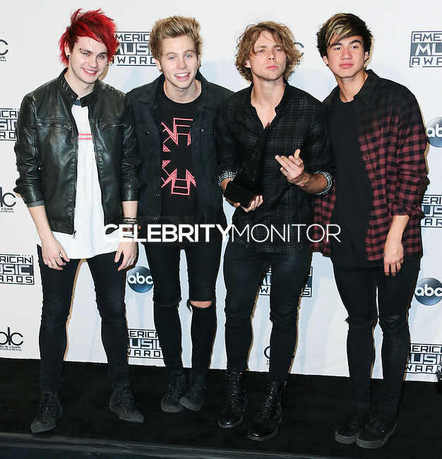 LOS ANGELES, CA, USA - NOVEMBER 23: Michael Clifford, Luke Hemmings, Ashton Irwin, Calum Hood, 5 Seconds of Summer pose in the press room at the 2014 American Music Awards held at Nokia Theatre L.A. Live on November 23, 2014 in Los Angeles, California, United States. (Photo by Xavier Collin/Celebrity Monitor)