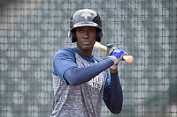 Shortstop Ronny Mauricio (2) of the Columbia Fireflies works a bunting drill before a game against the Charleston RiverDogs on Friday, April 5, 2019, at Segra Park in Columbia, South Carolina. Charleston won, 6-1. (Tom Priddy/Four Seam Images)