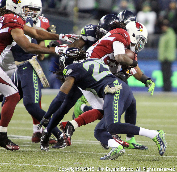 Arizona Cardinals running back Chris Johnson (23) runs against the Seattle Seahawks Kam Chancellor (31) and Richard Sherman (25) at CenturyLink Field in Seattle, Washington on November 15, 2015. The Cardinals beat the Seahawks 39-32.   ©2015. Jim Bryant photo. All Rights Reserved.