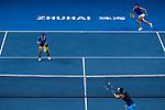 Jing Xinyu Jiang (L)  and Qianhui Tang (R) of China in action during the doubles Round Robin match of the WTA Elite Trophy Zhuhai 2017 against Jing-Jing Lu and Shuai Zhang of China at Hengqin Tennis Center on November  04, 2017 in Zhuhai, China. Photo by Yu Chun Christopher Wong / Power Sport Images