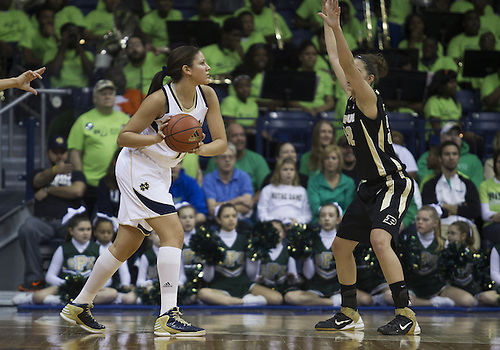 December 29, 2012:  Notre Dame forward Natalie Achonwa (11) looks to pass the ball as Purdue forward Sam Ostarello (32) defends during NCAA Women's Basketball game action between the Notre Dame Fighting Irish and the Purdue Boilermakers at Purcell Pavilion at the Joyce Center in South Bend, Indiana.  Notre Dame defeated Purdue 74-47.
