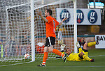 Jon Daly celebrates his goal for Dundee Utd to the home support
