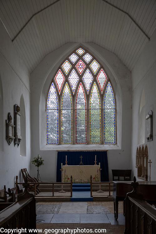Interior village parish church of Saint Peter, Westleton, Suffolk, England, UK east window and altar