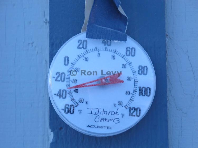 thermometer showing minus 35 degree temps outside Unalakleet checkpoint, Iditarod 2012, Alaska