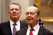 United States Secretary of Commerce Wilbur L. Ross, Jr. (right) and US Trade Representative Robert Lighthizer share a laugh prior to US President Donald J. Trump announcing David Malpass as his choice to lead the World Bank, in the Roosevelt Room of the White House, Washington, DC, February 6, 2019.<br /> Credit: Martin H. Simon / CNP