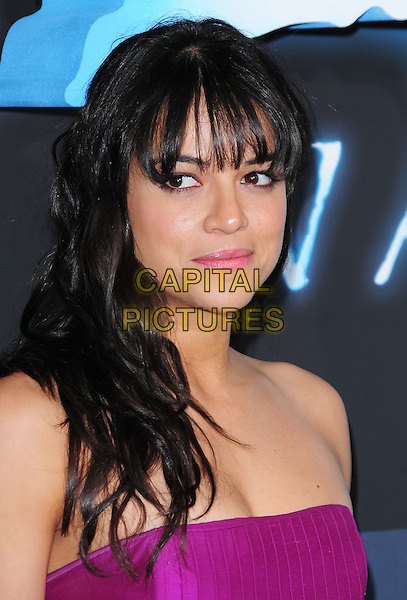 MICHELLE RODRIGUEZ.The Twentieth Century Fox World Premiere of Avatar held at The Grauman's Chinese Theatre in Hollywood, California, USA. .December 16th, 2009.headshot portrait strapless pink purple magenta fringe bangs hair .CAP/RKE/DVS.©DVS/RockinExposures/Capital Pictures.