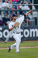 Jake Zokan #24 of the Everett AquaSox throws to first base after fielding a bunt during a game against the Tri-City Dust Devils at Everett Memorial Stadium on July 24, 2013 in Everett, Washington. Tri-City defeated Everett, 3-1. (Larry Goren/Four Seam Images)