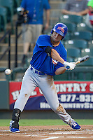 Iowa Cubs shortstop Tim Torres (18) swings the bat against the Round Rock Express in the Pacific Coast League baseball game on July 21, 2013 at the Dell Diamond in Round Rock, Texas. Round Rock defeated Iowa 3-0. (Andrew Woolley/Four Seam Images)