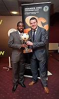 Pictured: Nathan Dyer (L) being given his Supporters Player of the Year award by Evening Post sports reporter Gareth Vincent. Wednesday 04 May 2011<br /> Re: Swansea City FC supporters Trust annual dinner at the Liberty Stadium, Swansea, south Wales.