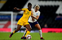 Princess Ibini-Isei of Australia battles with Alex Greenwood of England during the Women's International friendly match between England Women and Australia at Ashton Gate, Bristol, England on 9 October 2018. Photo by Bradley Collyer / PRiME Media Images.