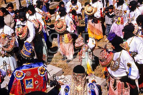 Paucartambo, Peru. Dancers wearing black hoods and carrying multi-coloured hats during the Fiesta del Carmen.