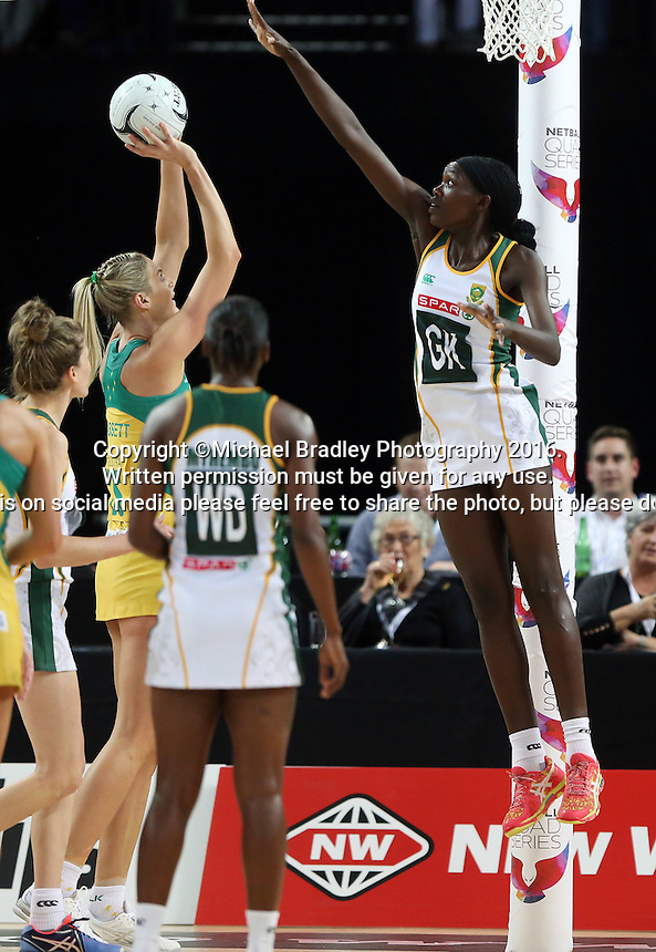 27.08.2016 South Africa's Phumza Maweni and Australia's Caitlin Bassett in action during the Netball Quad Series match between South Africa and Australia at Vector Arena in Auckland. Mandatory Photo Credit ©Michael Bradley.