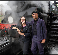 BNPS.co.uk (01202)558833<br /> Pic: PhilYeomans/BNPS<br /> <br /> Young blood - Beth Attfield-Haines (29) and Driver Nathan Au (27) <br /> <br /> Growth Industry - Britain's enduring love affair with steam trains has led to a critical shortage of drivers, 56 years after the infamous Beeching Axe was supposed to have fallen.<br /> <br /> More steam train's are running today than at anytime since Dr Beechings drastic cut in 1963 - with over 150 steam heritage railways and museums attracting 13 million visitors a year.<br /> <br /> One of the most popular heritage railways in the country has put out an SOS for steam drivers - as so many of its stalwarts are retiring.<br /> <br /> Swanage Railway in Dorset has 42 steam drivers on their books, but the majority are in their 60s or older and likely to step down in the coming years.<br /> <br /> They need to train up to 40 drivers over the next five years to replace them and meet their expanding service, which attracts over 200,000 visitors each year.<br /> <br /> To fill the void, a group of enthuisastic young volunteers are being taught the skill, a process which can take up to a decade.<br /> <br /> The Heritage Railway Association, which oversees them, says some of their railways have a 'more pressing need for new blood'.