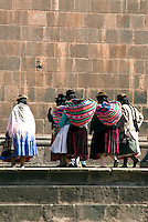 Woman gather in the Plaza de Armas in Cusco. The traditional Inca anacu was transformed by the local women into the brightly-colored and multi-layered petticoats known as polleras. The Peruvian poncho dates back to the 17th century.